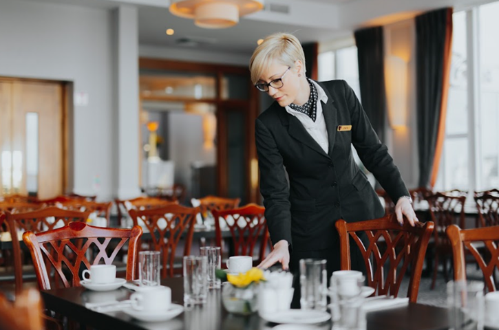 Grand Hotel | Dublin | Staff member setting tables in the Coast Restaurant