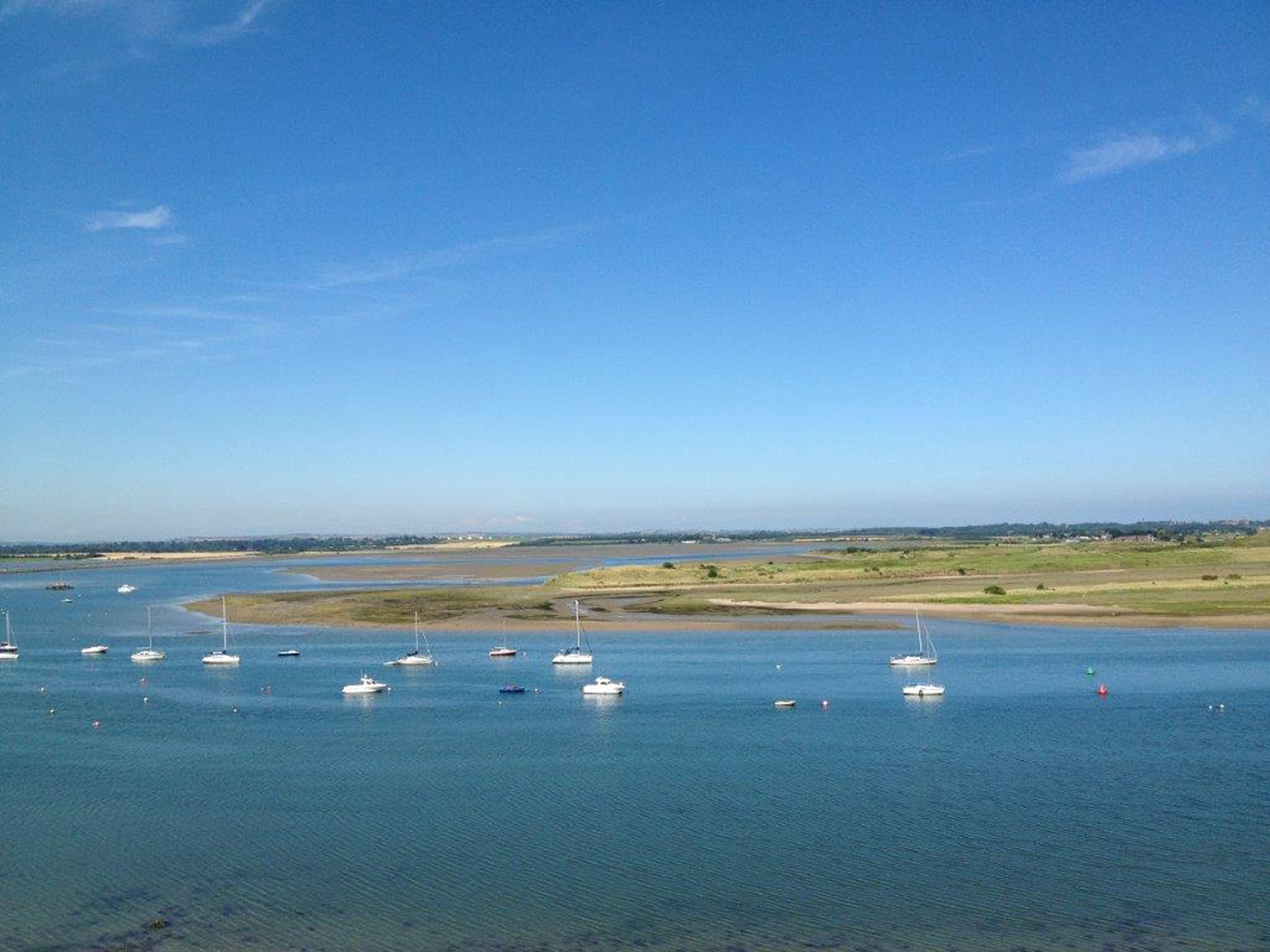 Malahide beach on a Summer day, overlooking small boats and the estuary