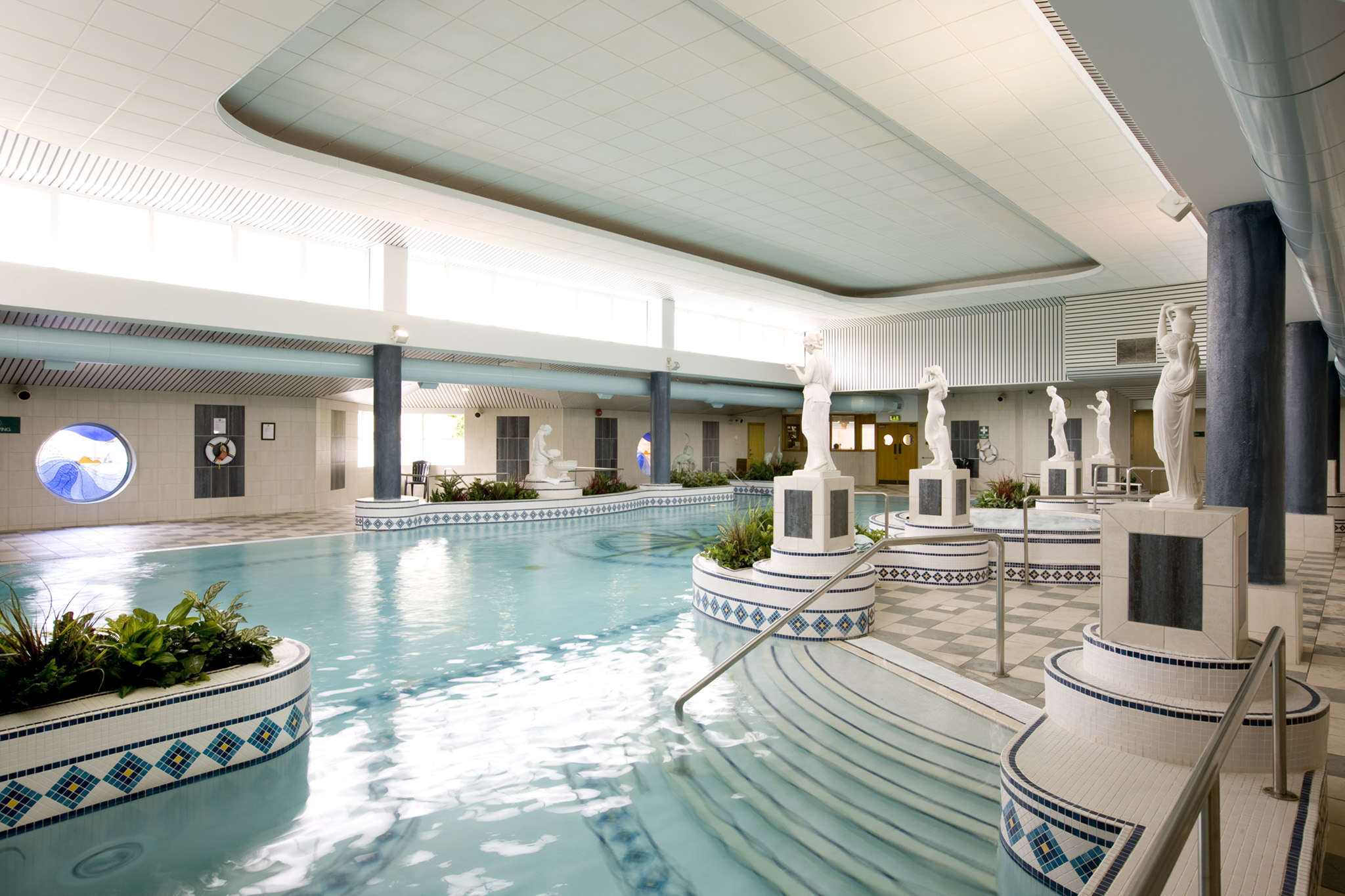 Spacious pool and ornate decorations in the Arena Health and Leisure center
